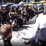 """Pam Martens ~ May Day Protesters With Sign """"It's Not A Crisis, It's A Scam,"""" Cuffed And Jailed By NYPD"""