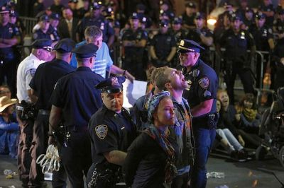 Protesters chant as they are arrested at the intersection of Wall Street and Broad Street in New York on Sept. 22. The protesters, many of whom were affiliated with Occupy Wall Street, were pointing to the connection between capitalism and environmental destruction. AP/Seth Wenig